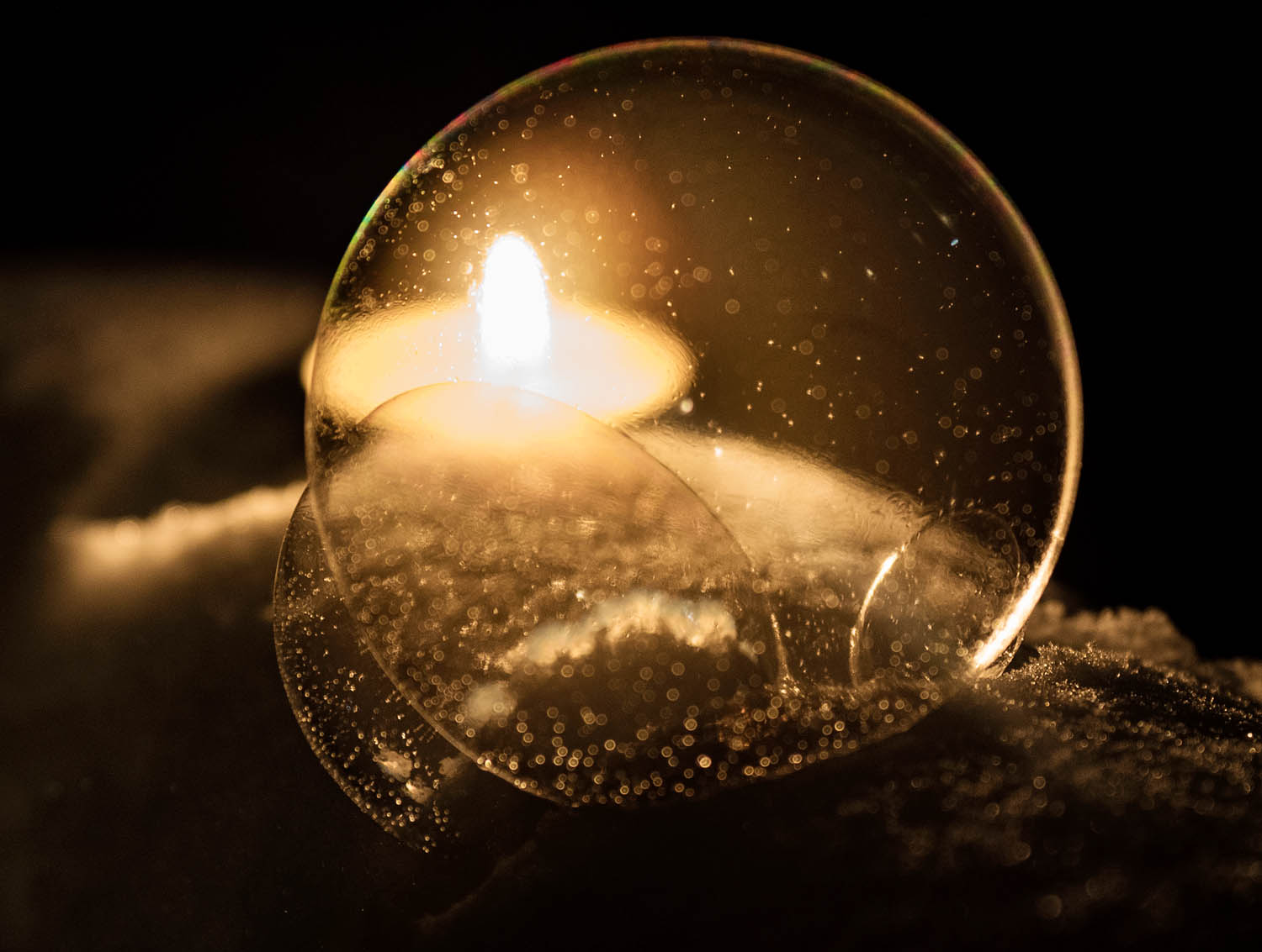 Image: Using a candle to illuminate a bubble at night