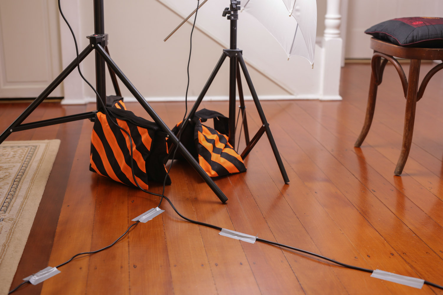 Image: Sandbag those lights and gaffer those cords so that you don't end up responsible for a trip t...