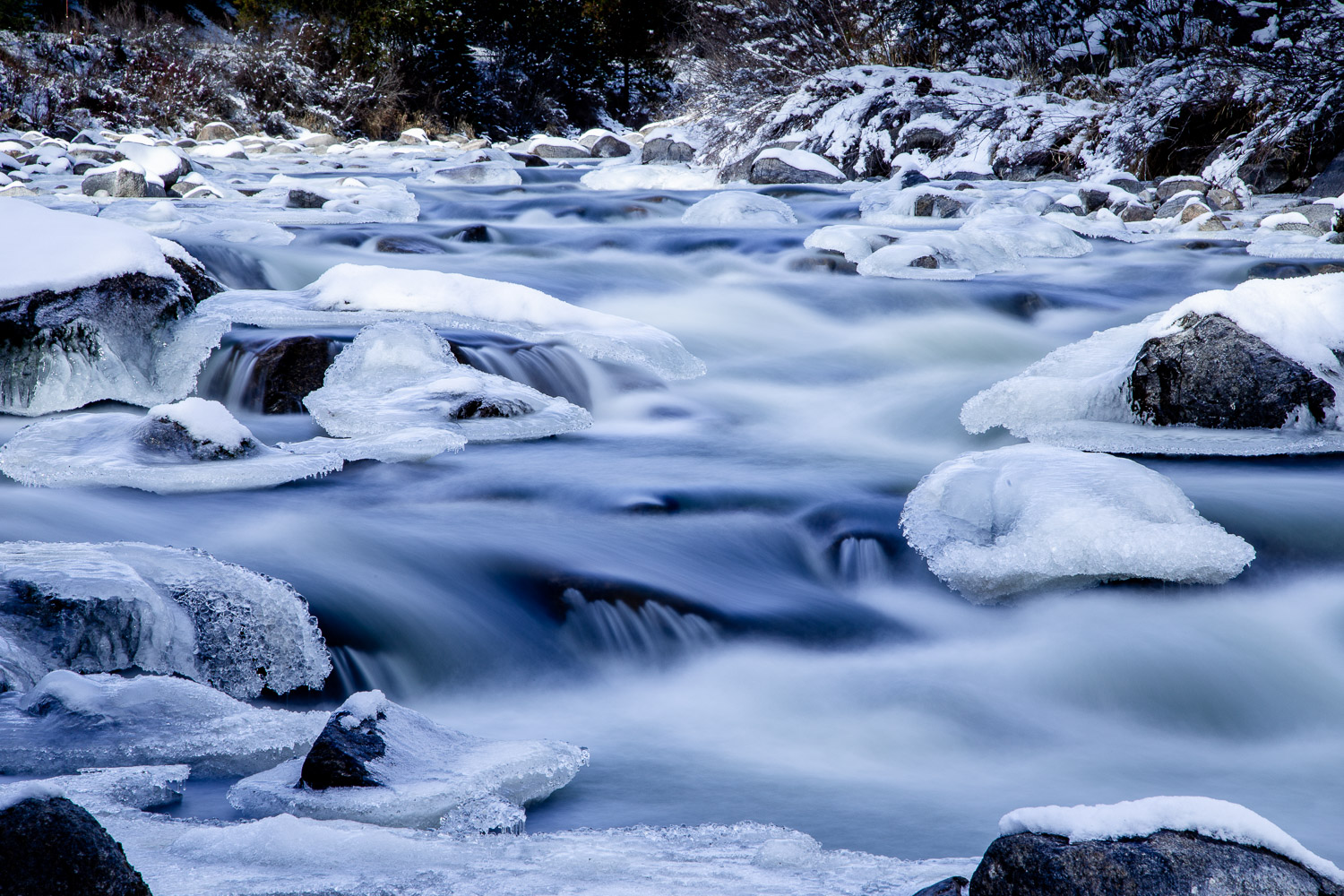 Image: A long exposure blurs the liquid water, but the ice on the rocks is still, a way to display t...