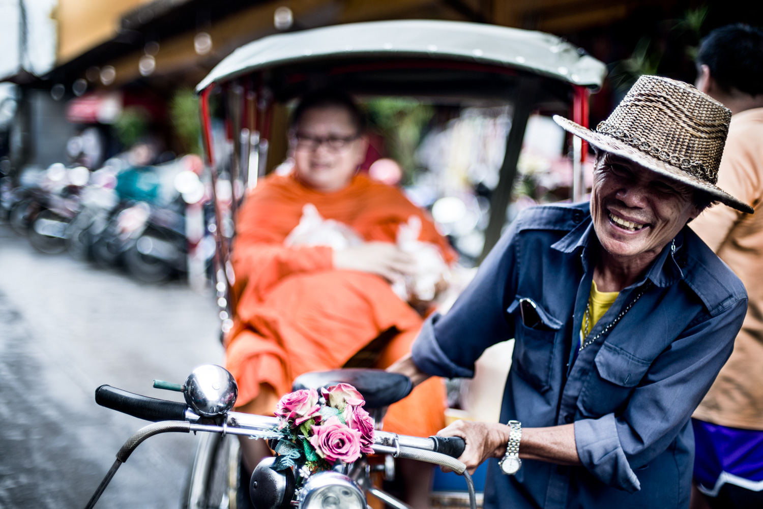 Monk in a Saamlor tricycle taxi in Chiang Mai, Thailand.
