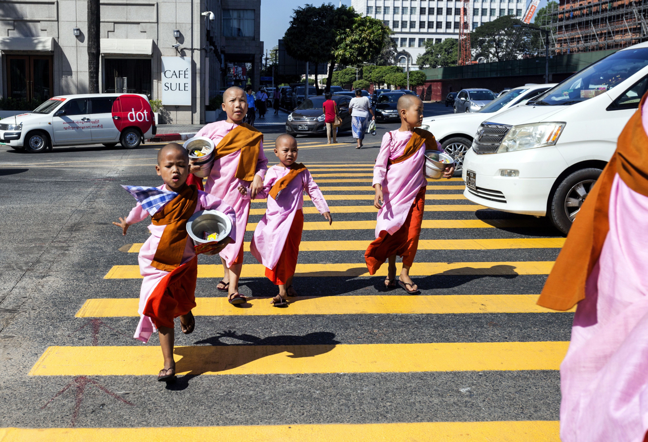Image: There are times you need to be aware and very fast. These monks crossing the street is a spli...