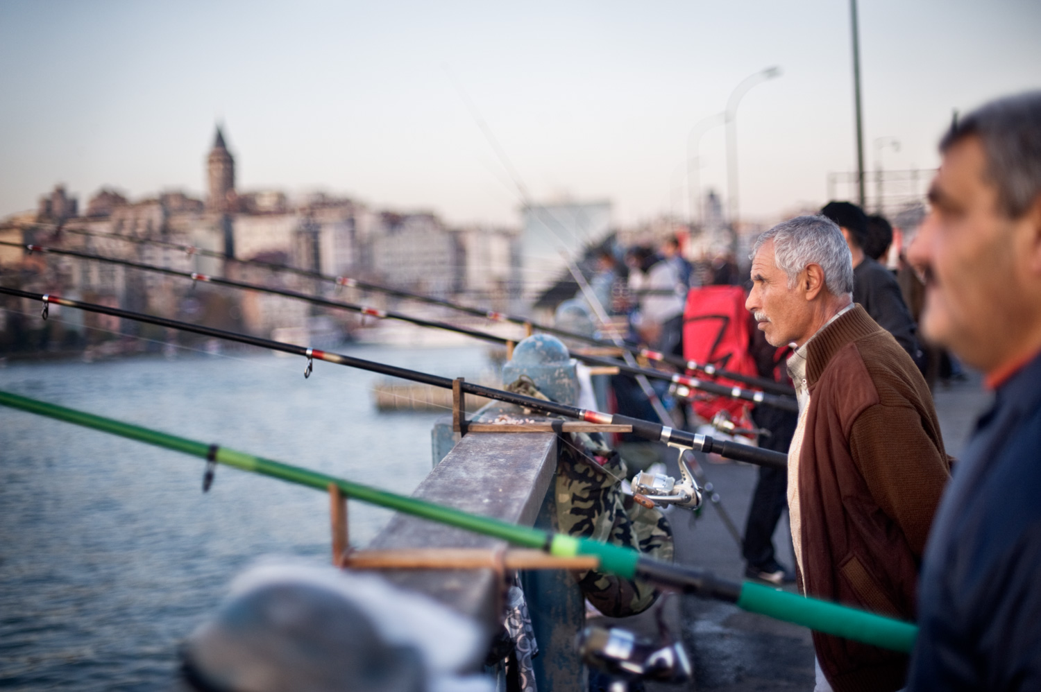 Fishermen on a bridge DPS Ultimate Guide to Photographing People for Shy Photographers