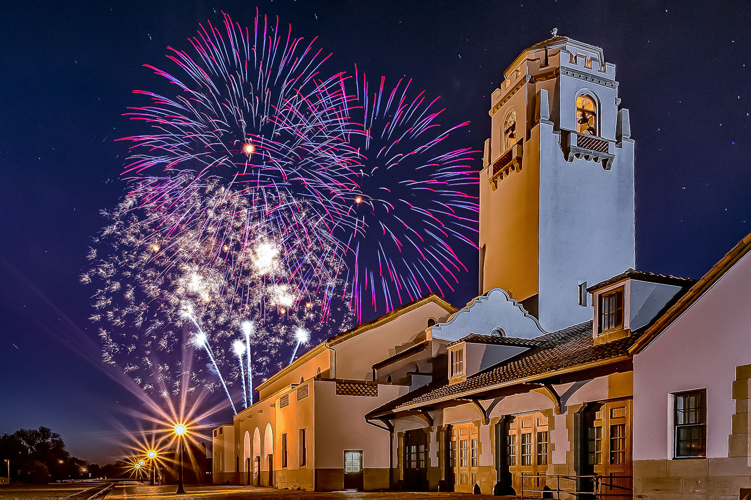 Image: Include a landmark, city skyline, or something in your fireworks photo to add interest, place...