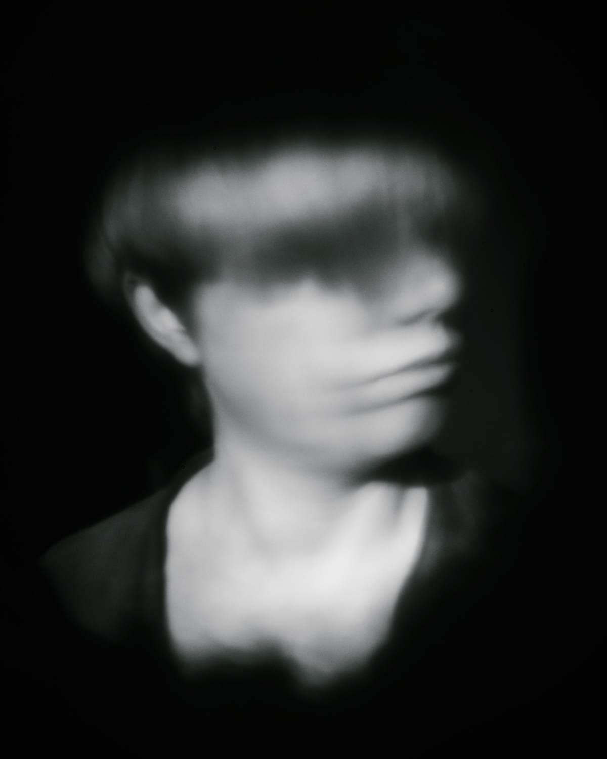 blurry portrait pinhole body cap camera