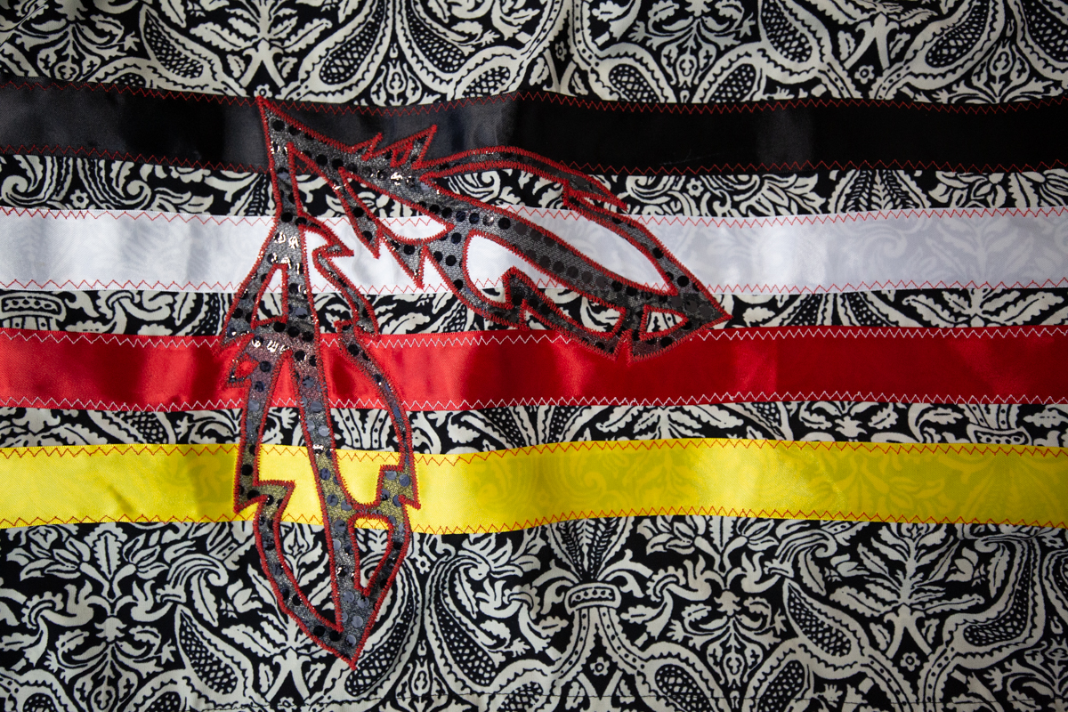 A woman's traditional ribbon skirt