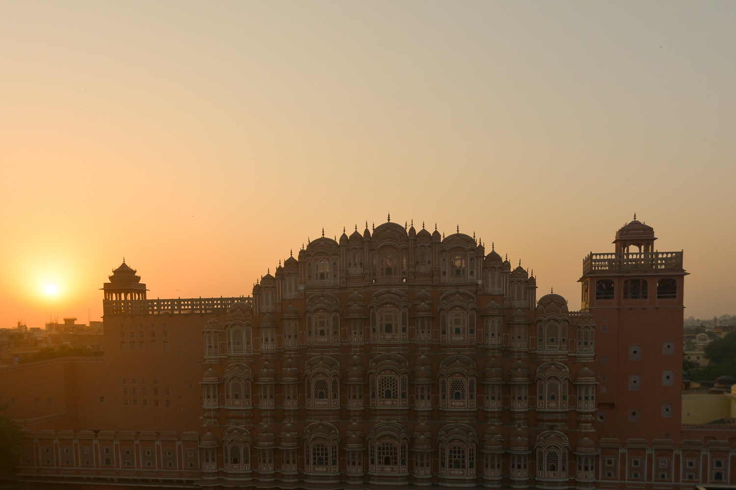 Image: An early morning sunrise against Hawa Mahal In Jaipur