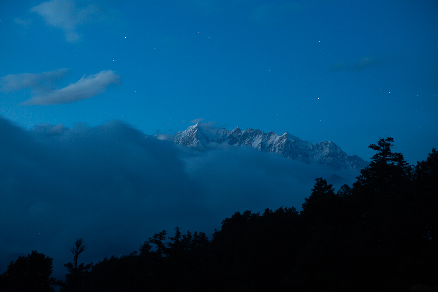 Image: The clouds and fog rolled in at night creating an almost eery effect to the Himalayas as I wa...
