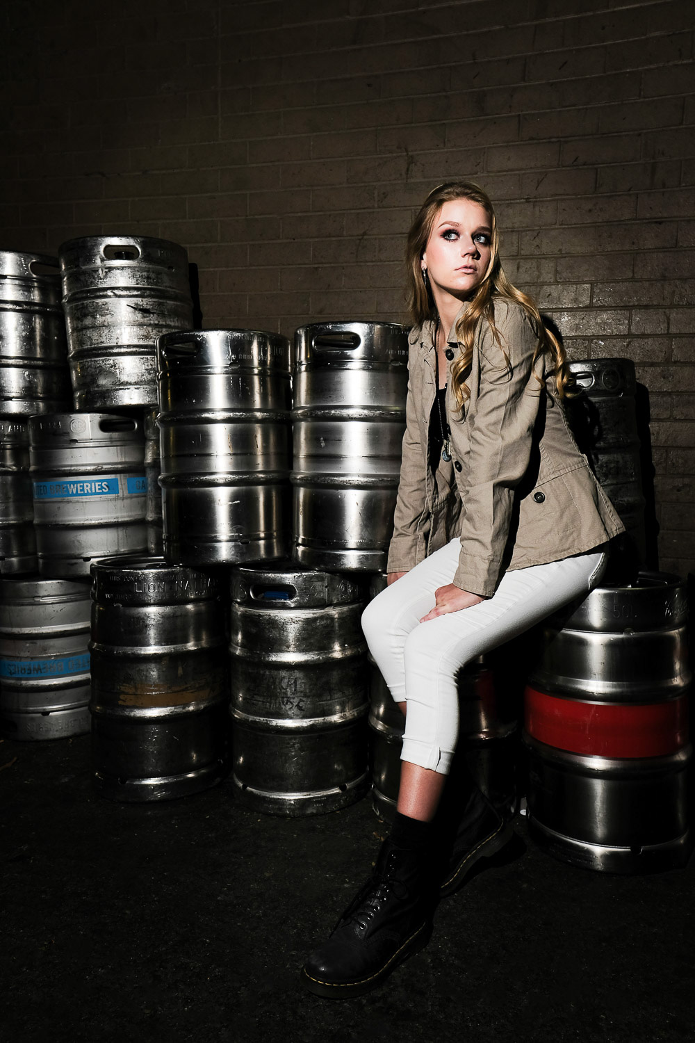 Image: Sasha sitting on beer kegs in a Brisbane laneway. There wasn't much room in the laneway...