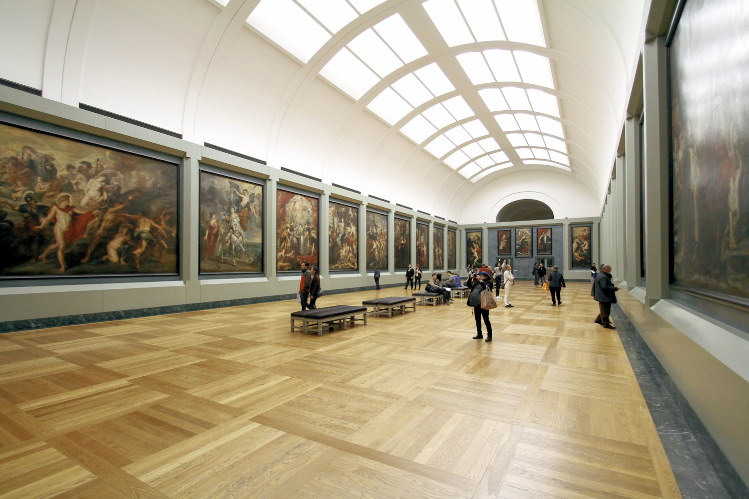 Image: Art museums and galleries use one light source to illuminate paintings. It might be overhead...