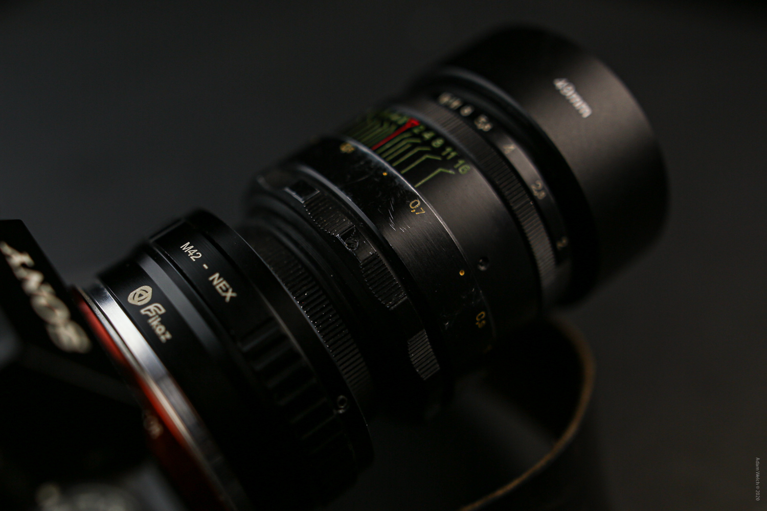 You can use old lenses with new digital cameras by means of an adapter