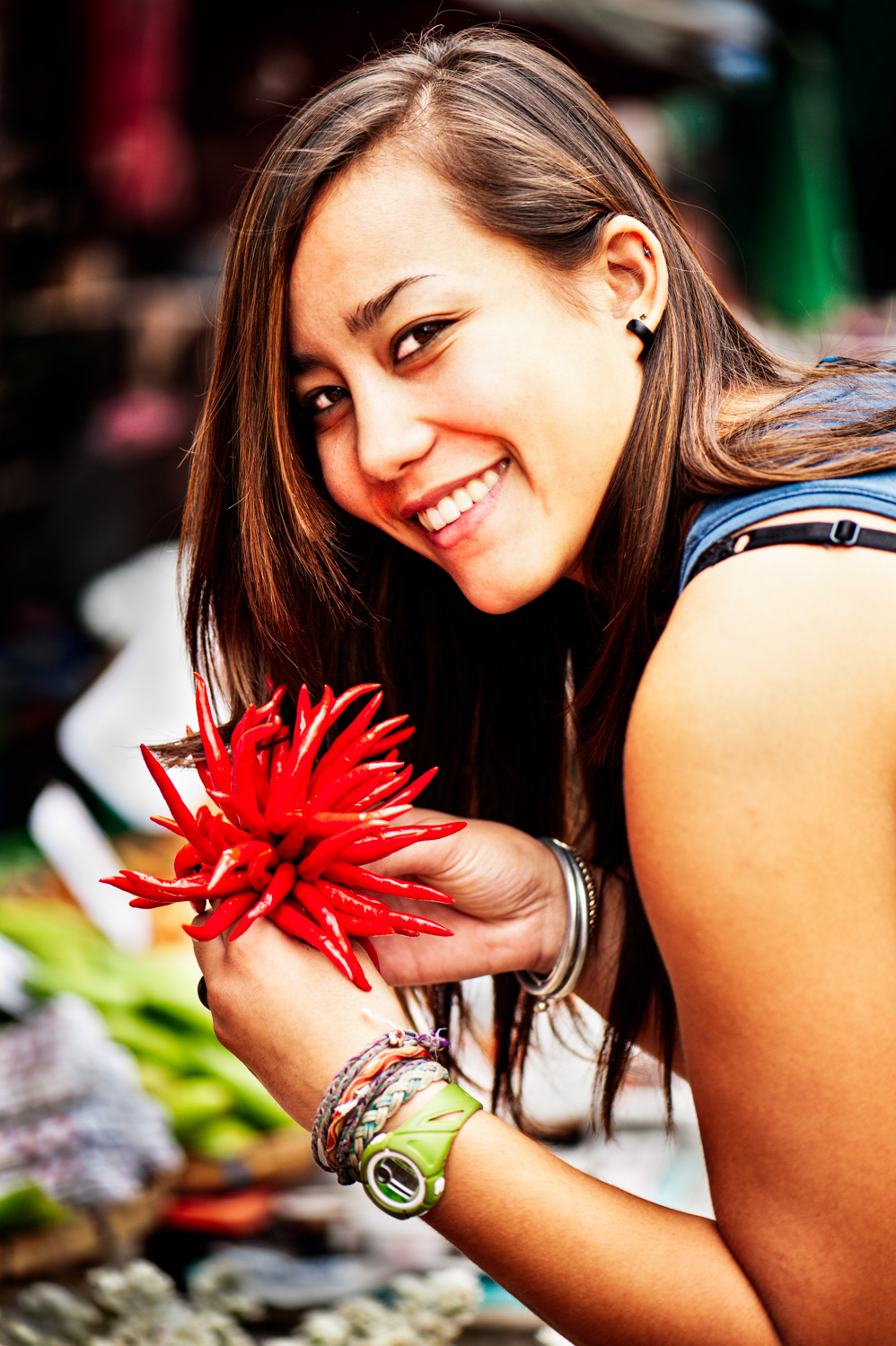 Woman holding chilli pepper as a prop for making someone comfortable