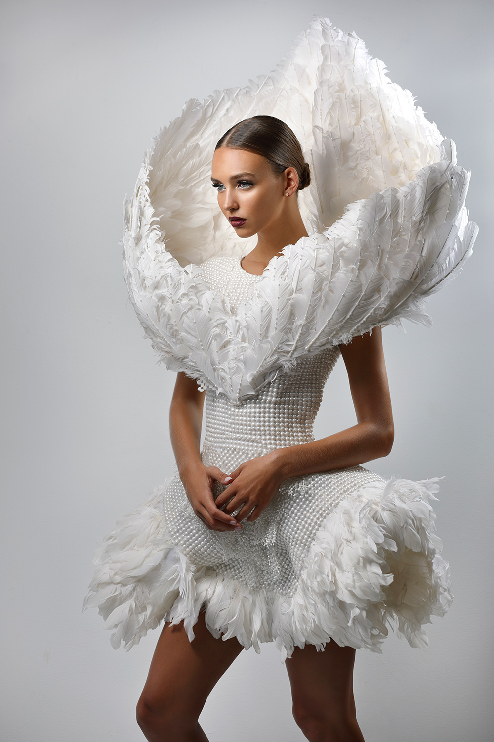 Canon Explorers of Light – Q&A with Photographer Roberto Valenzuela Fashion photography example of Woman with feathers