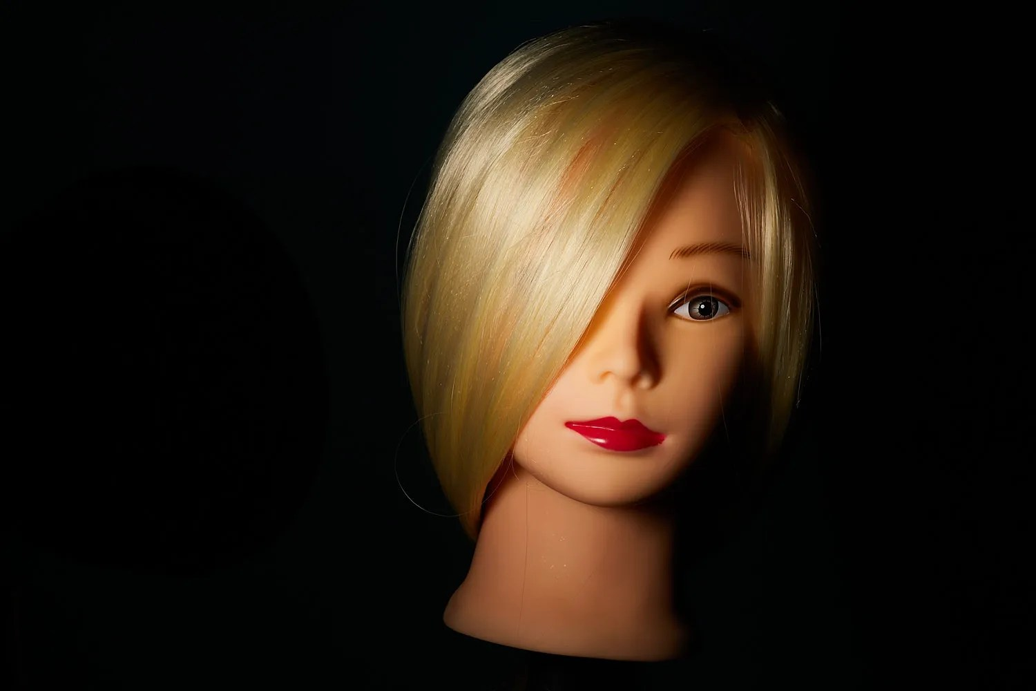 A dummy head showing the inverse square law in action. The head is close to the flash darkening the background