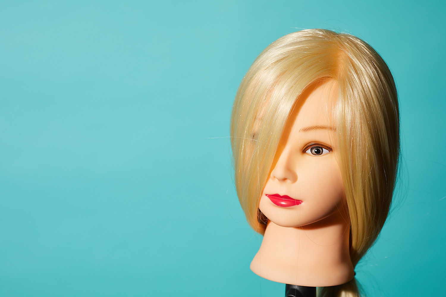 A dolls head against a plain background exposed correctly
