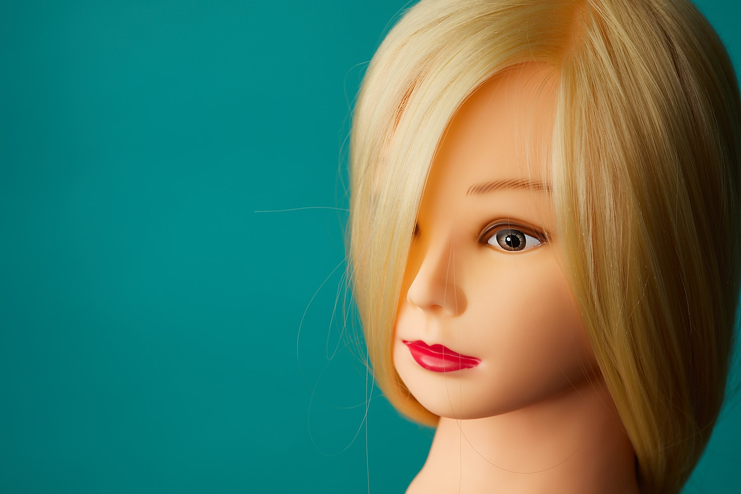 A mannequin is great when starting in off-camera flash. This image is shot with a soft box against a blue background.