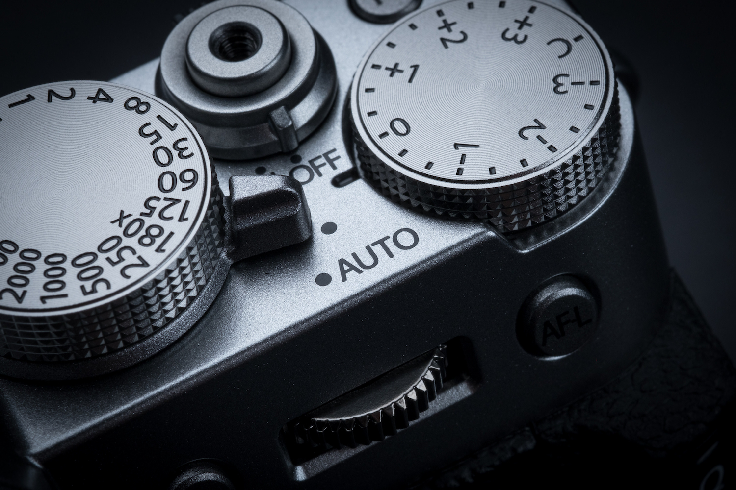 Fuji camera close up showing dials and shutter button