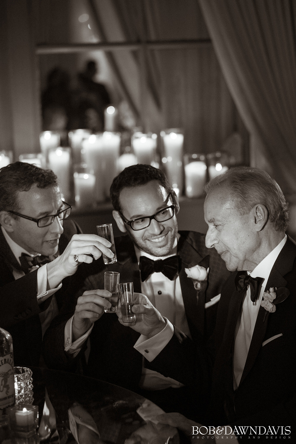 Men making a toast at a wedding. Photo by Photographers Bob and Dawn Davis.