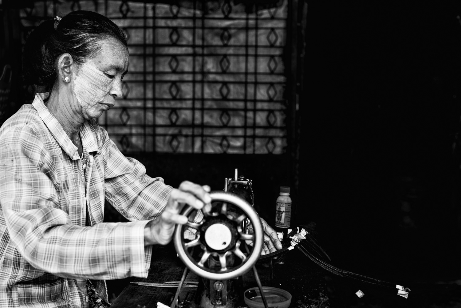 Woman sewing with an old machine