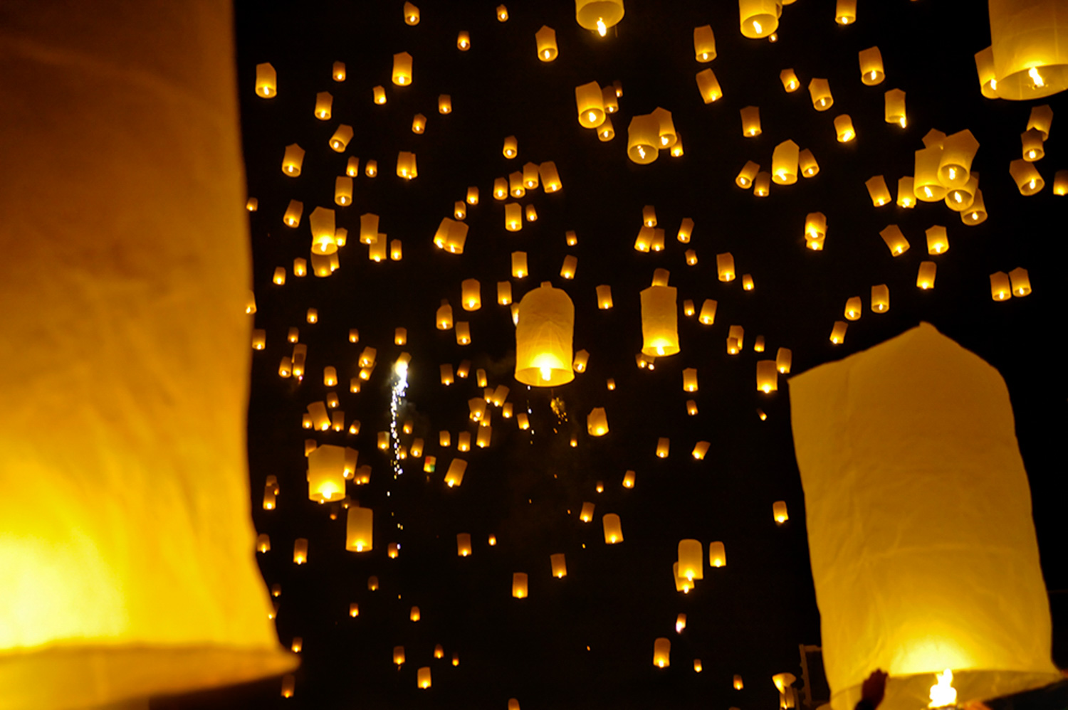sky lanterns being released a festival in Thailand.