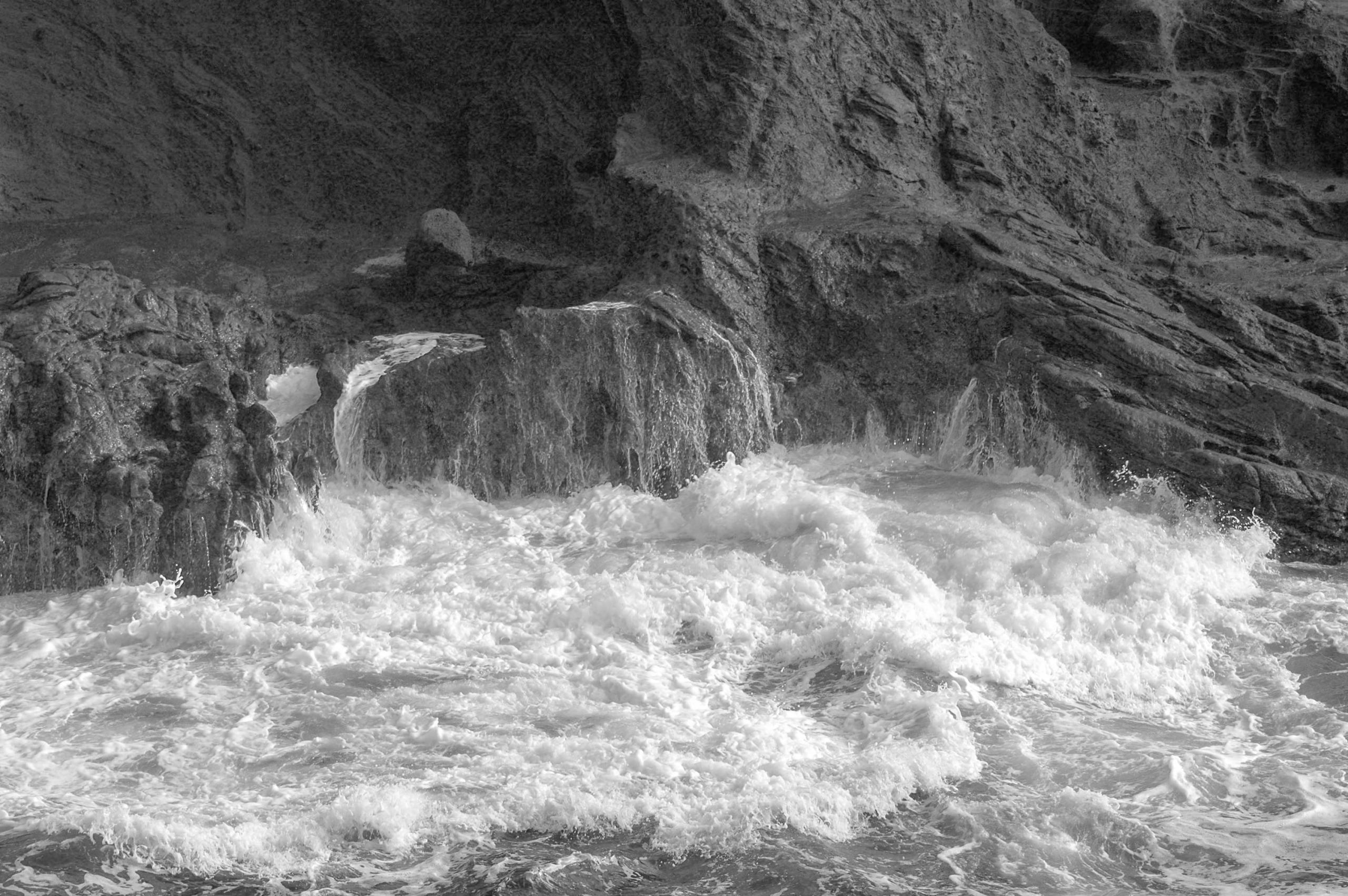 Black and White are Rarely Black or White – waves crashing on rocks