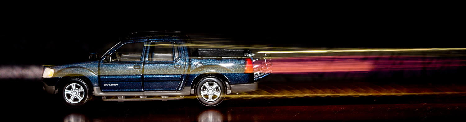 Flash action photo - Scale model of the author's 2003 Ford Sport Trac.  Second curtain sync flash.