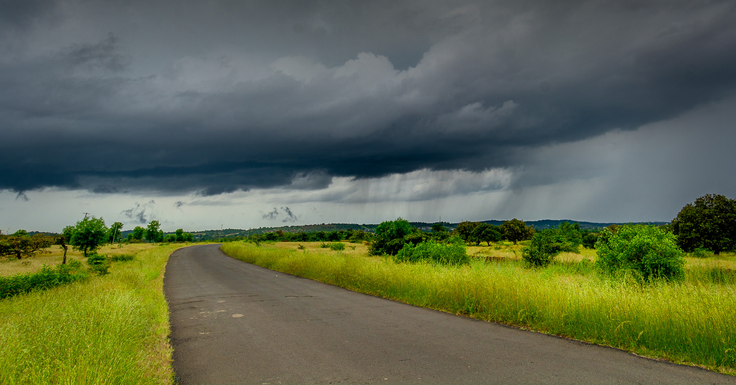 final edited road with storm clouds using lightroom tools nature photography