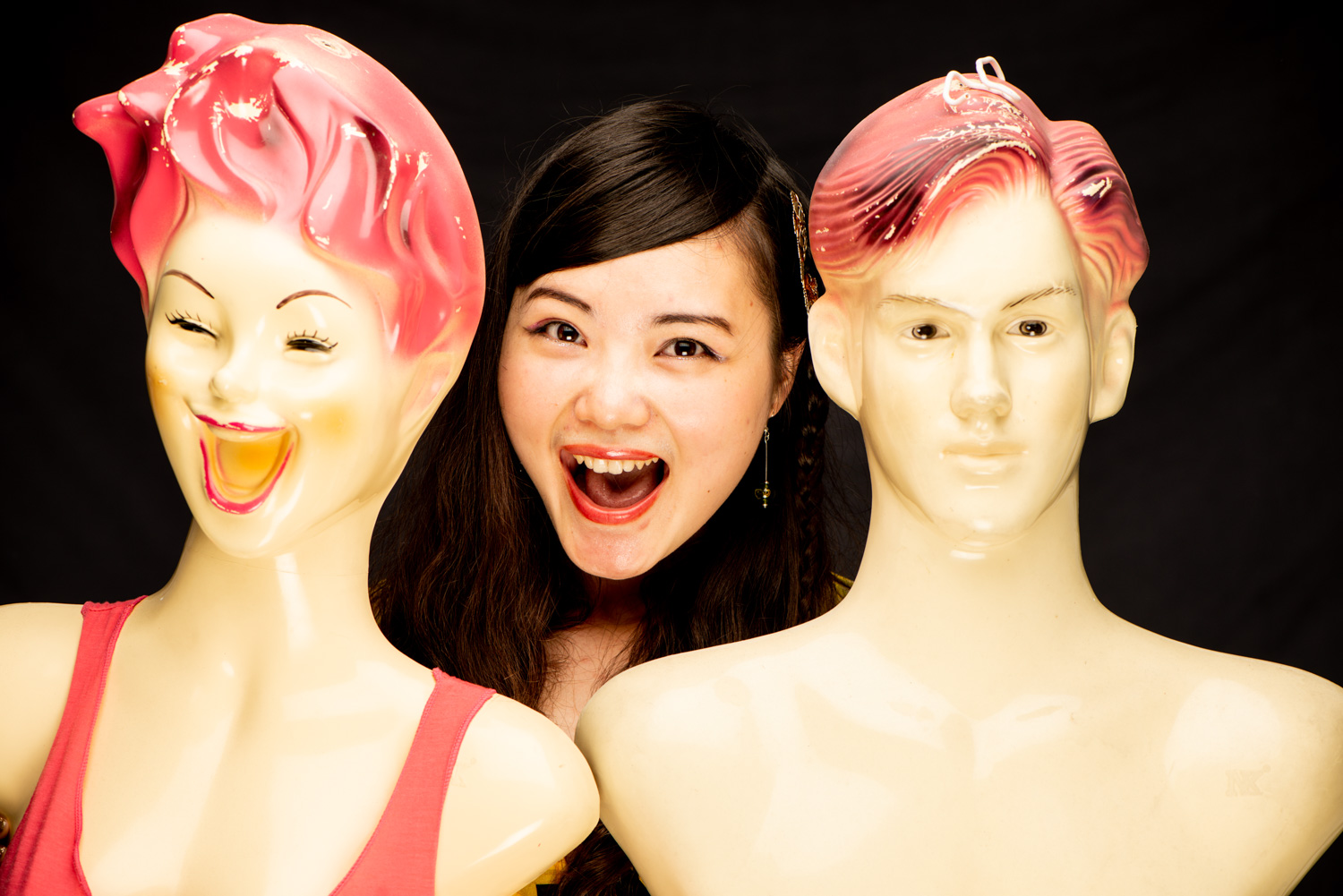 Two mannequins and a girl for frame within a frame photography