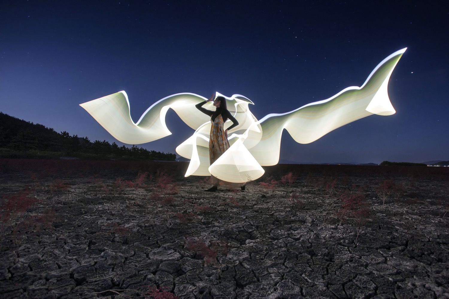 tips to boost your creativity woman with light painting