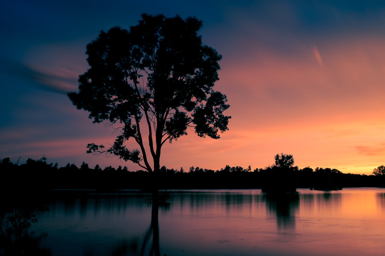 Sunset on a lake with color grading