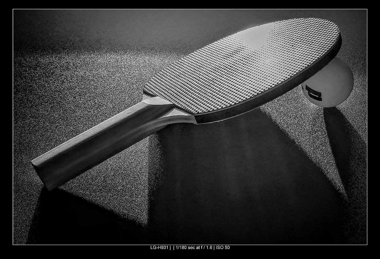 ping pong paddle in black and white