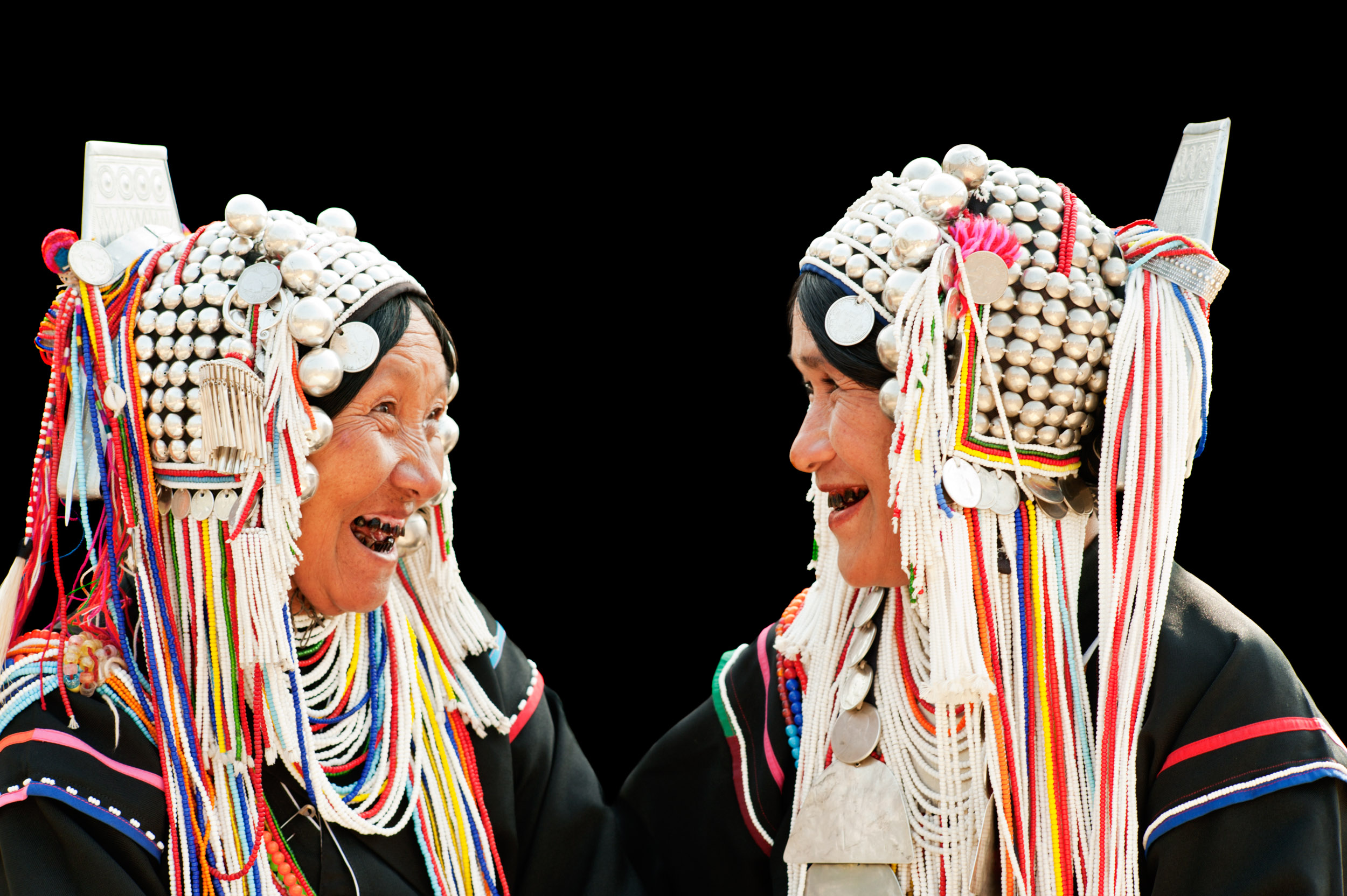 Two Akha woman having a laugh portrait photography idea