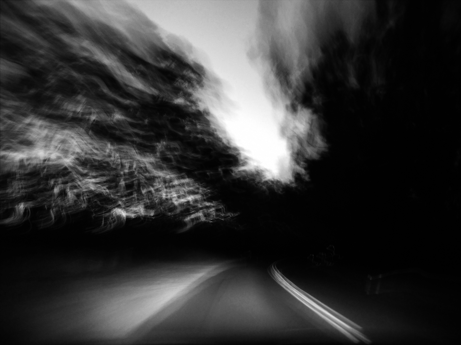 experimental phone photo of a blurry road