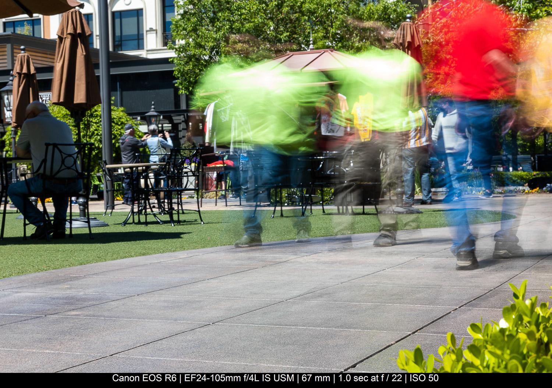 people walking along outdoor seating