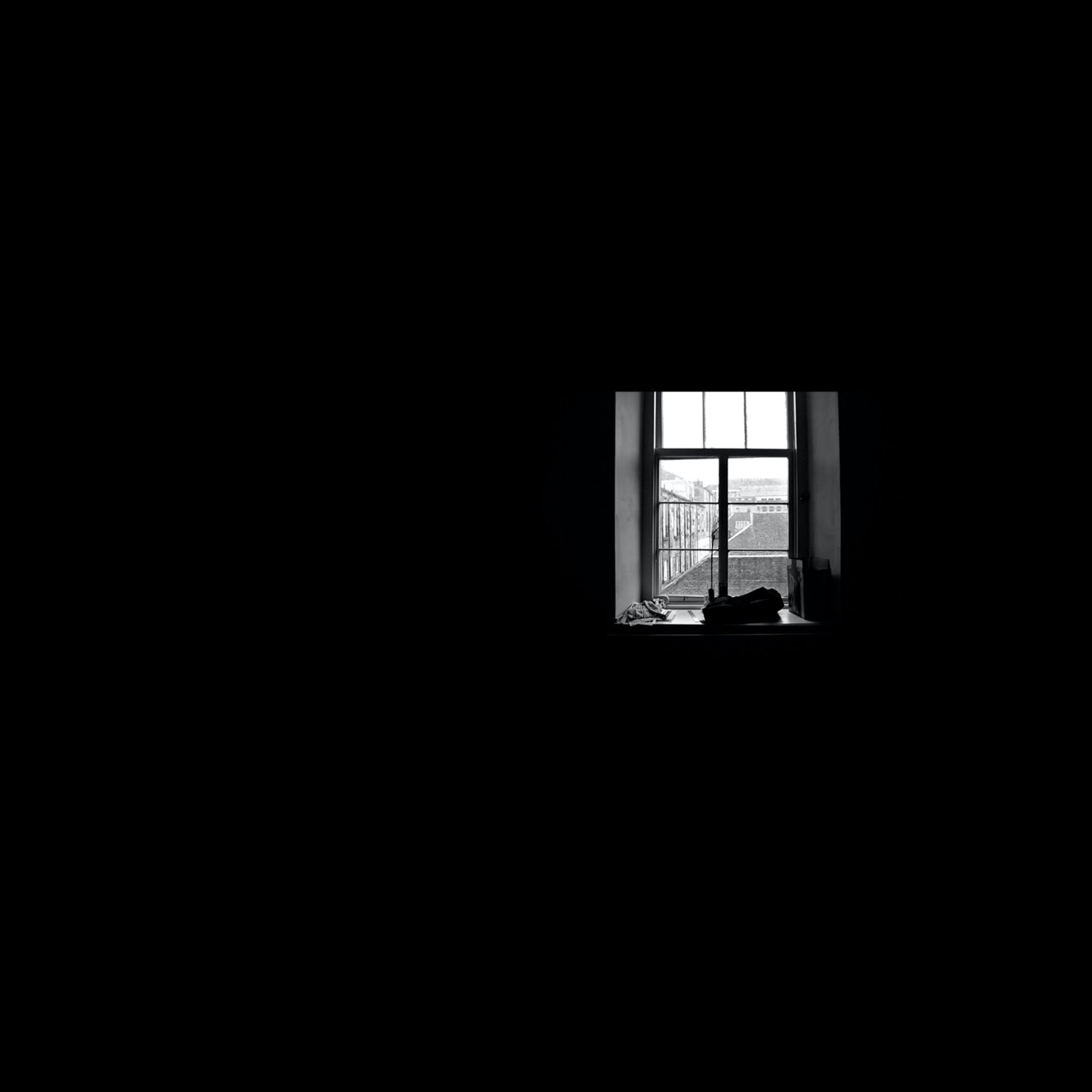 an underexposed image of a room