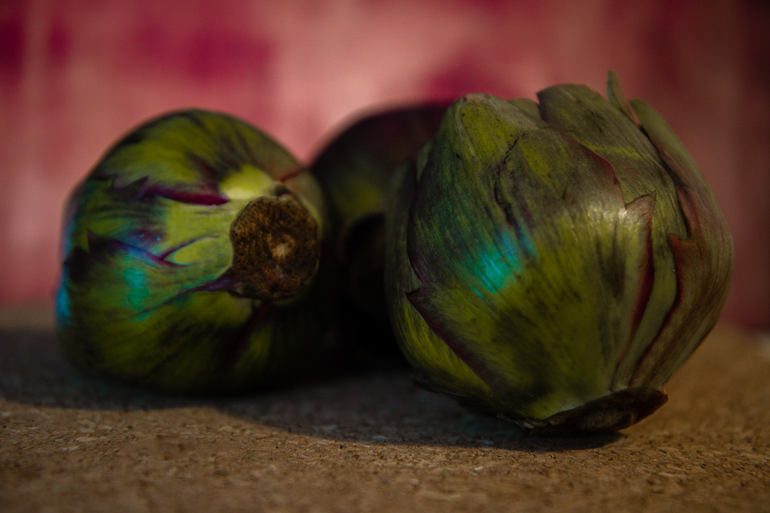 artichokes with a pink backdrop