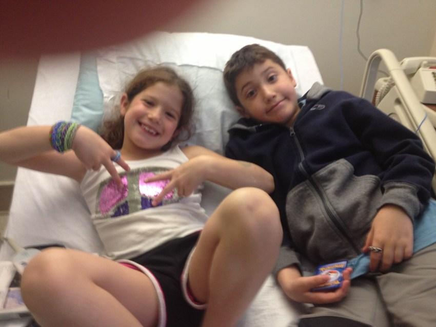 KIds enjoying Spongebob even in a hospital bed