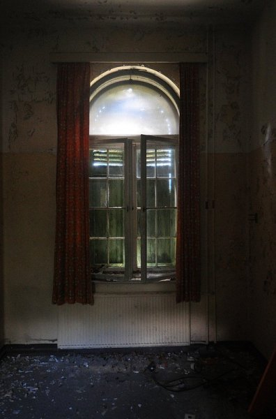 another abandoned room with red curtains