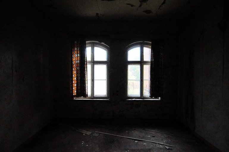 orange curtains in an abandoned room