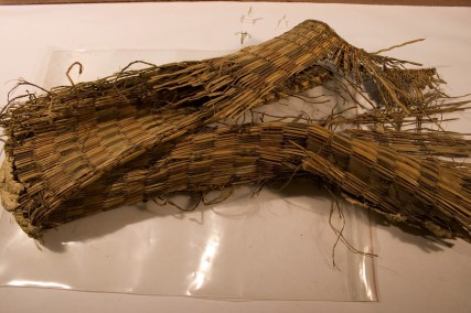 A fragment of grass matting found inside a rodent's nest during the Restoration Project.
