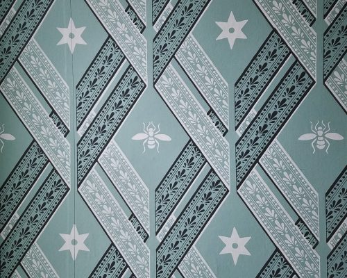 A sectional close up of the Bees & Stars wallpaper in Dolley Madison's son's room, John Payne Todd.