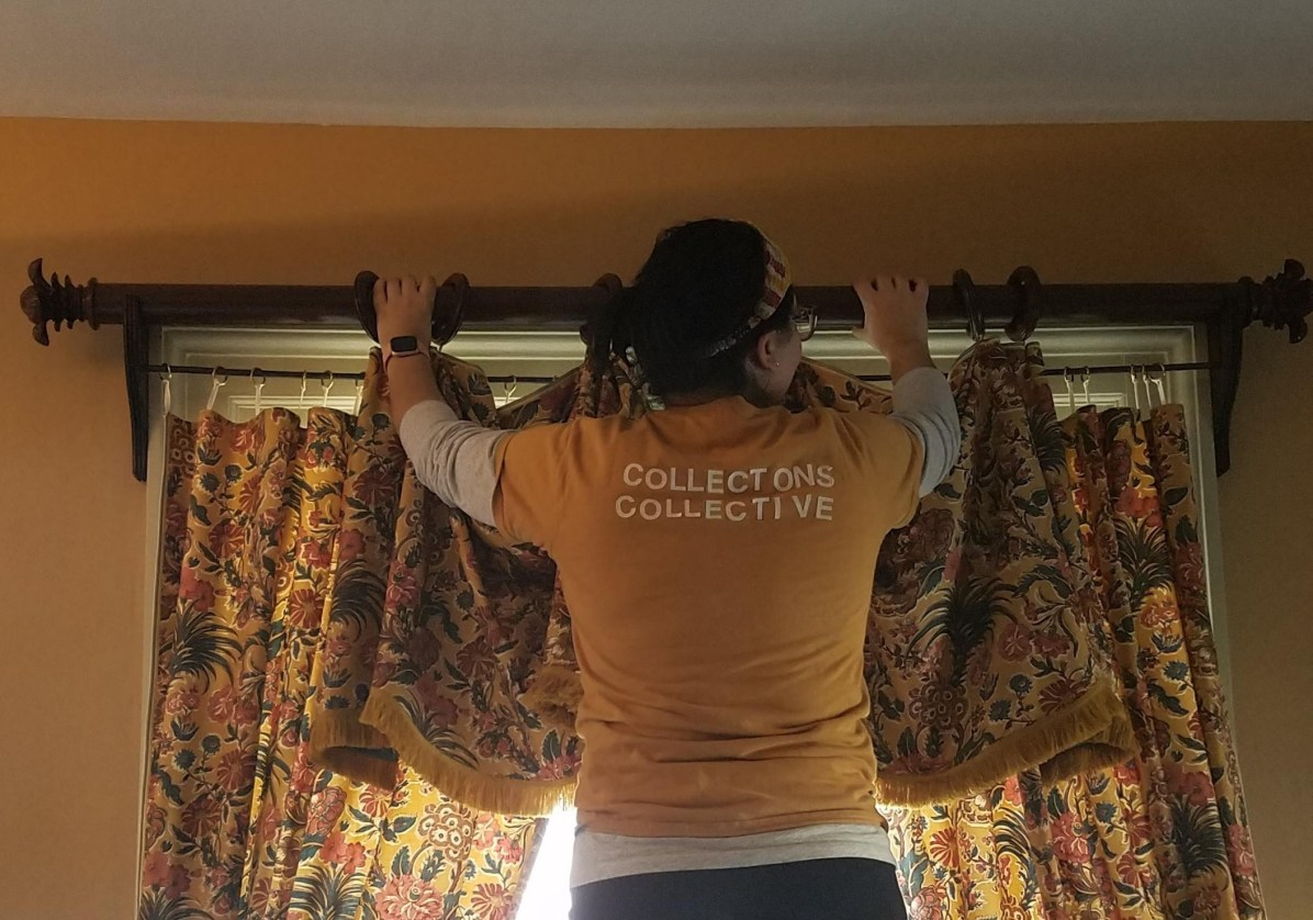 Removing window hangings from the Large Bedchamber