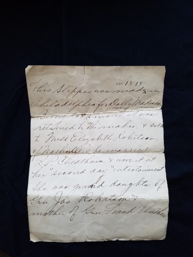 A 1818 handwritten note telling the family's history of the shoes.