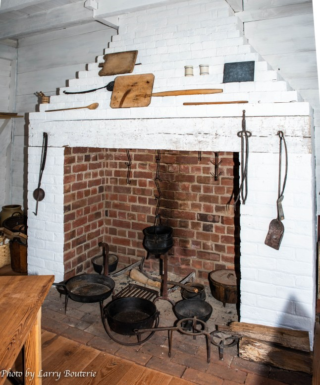 View of the fireplace in one of the South Yard dwellings. Notice the slate board above the fireplace, to the right.