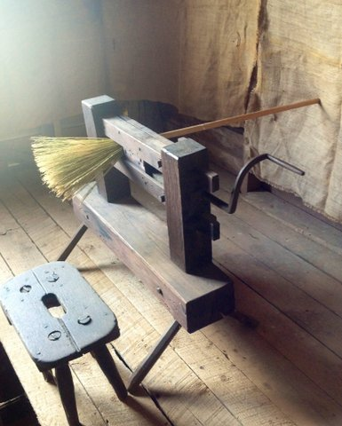 Foot treadle broom machine, image courtesy of The Kick N' Stitch Corn Broom Museum