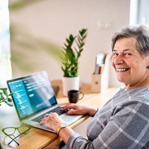 Woman using a Mac laptop