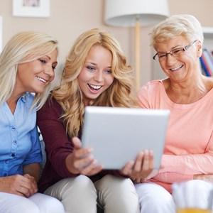 Generations of women enjoying digital entertainment
