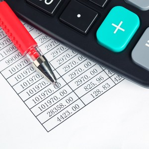 Printed spreadsheet, pencil and calculator