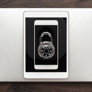 Combination lock on top of laptop, tablet and phone