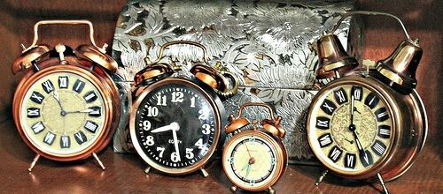 Image of four old fashioned clocks