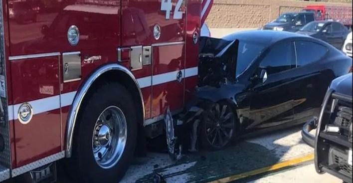tesla damage by firetruck